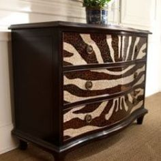 Spotted at Horchow for $3379.  Second Hand Dresser Inspiration.  Can I do this by using Waverly Modern Essentials Fabric, Wild Life in Onyx and some Hodge Podge????  Or scrapbook paper in a zebra print; Hodge Podge; a clear, crack paint finish; and some Rub 'n Buff????  Stay tuned...