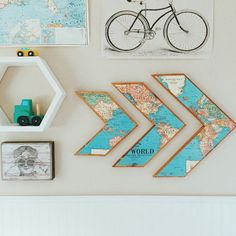 Add charm to your home with a beautiful set of wooden world map arrows.  DIMENSIONS:  Small Arrow: Width:11.5 inches Length: 12 inches thickness: