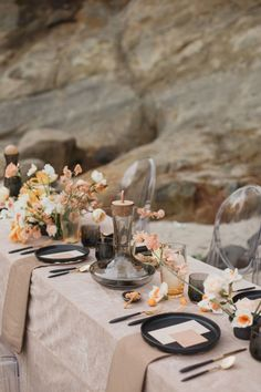 kumquat tablescape with ghost chairs for a beach wedding
