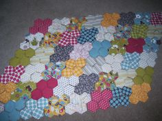 Hexagon quilt beginnings I may have to do this with my leftovers.....