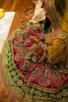 Mehendi www.weddingstoryz.com bridal wear ideas designs patterns lehenga outfit zari zardozi indian weddings red