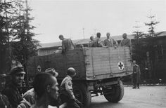 Soldiers of the 139th Evacuation Hospital take sick prisoners out of Ebensee