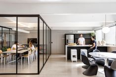 Todos Arquitetura embarked on the design of their offices located in São Paulo, Brazil. One of the most famous sights of São Paulo, the Paulista Avenue is Cafe Interior Design, Cafe Design, Lounges, Navy Blue Sofa, Communal Table, Glass Structure, Black Countertops, Ergonomic Chair, Architecture Office