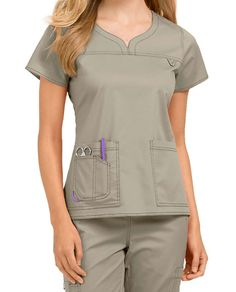 Treat yourself to the style and quality of the MC2 by Med Couture collection! The new Lexi scrub top is highlighted by cute accents such as a notch neckline, front yoke, and utility loop. Two roomy pockets (plus a handy cell phone pocket) give you plenty of space to hold your important accessories throughout the day. You'll love how the stretch fabric feels to wear during your shift. Med Couture MC2 Lexi Notch Neck Scrub Tops Notch neck Two patch pockets and a cell phone pocket Si...