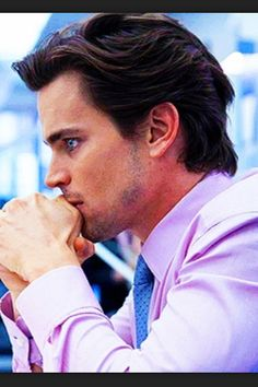 Neal Caffrey...... perfect profile action from Bomer yet again.