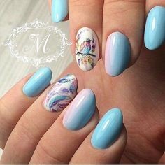 Light Blue Nails with Multi- Rainbow themed Alternates. This amazing light blue nails are definitely the best thing you can have.