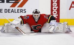 Flames goalie Kiprusoff stretches before the start of their NHL hockey game against the Ducks in Calgary Hockey Helmet, Hockey Goalie, Hockey Games, Ice Hockey, Goalkeeper, Spongebob, Calgary, Ducks, Nhl