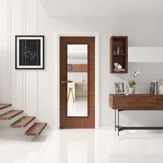 This walnut Ravenna door comes with clear glass. The Ravenna uses both vertical and horizontal grain directions to create a sleek modern style door. The clear glass version is perfect to lighting up rooms in your home. Use walnut style doors with dark or even white architrave and skirting for a contrasting style.