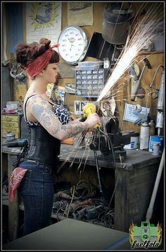 I both love and hate this photo. It's badass, but good lord, woman, get some gloves and eye protection! and sleeves! metal flakes from grinders can HURT. #askmehowIknow