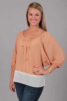 PEACHY SWEET TOP...WARNING: You will be sorry if you miss out on this top!!! From the crisp color combo to the colorblocking, we are in LOVE!! The fit is great for any shape or size, and the flowy sleeves are right on trend:) This top features a subtle sheen all over, making for a super expensive look! Pair it with dark denim to complete your look.