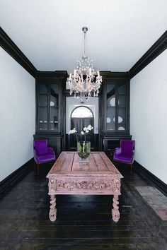 I love the black wood floor and crown molding.