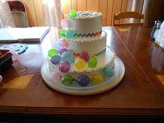 Fondant covered polka-dot cake (inside) with gelatin bubbles and cloth rick-rack embelishment.