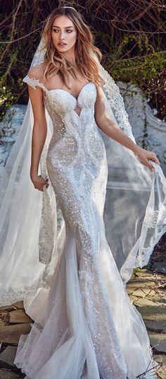 Modern wedding dress collection/ 2018/ wedding dresses/ Follow me @ Melissa Riley- for more modern wedding ideas, modern eye makeup ideas, wedding cakes, wedding engagement rings, wedding cakes, wedding bouquets and color palate ideas. transcendentwoman