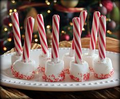 Marshmallows, candy cane sticks and sprinkles make the perfect hot cocoa stir sticks for Christmas.....Winter Party idea