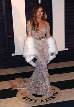 Pin for Later: 25 Looks From Last Year's Oscars That Practically Reinvented the Word Sexy Jennifer Lopez Jennifer Lopez shimmered and sparkled in a nude sheer dress with an ultralow neckline at the Vanity Fair afterparty.