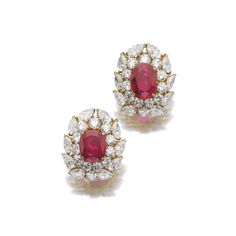 M. GERARD. Important pair of ruby and diamond ear clips, M. Gérard. Each centring on a cushion-shaped ruby weighing 6.03 carats and 7.11 carats respectively, within borders of brilliant-cut and pear-shaped diamonds, signed M. Gérard and numbered, French assay and maker's marks. SSEF / Gübelin / Burmese origin, with no indications of heating, Mogok region. #HighJewelry #Diamond #Ruby