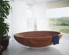 Round Wooden Bath-Tub.. if i had this i would feel like i was bathing in a cereal bowl :D