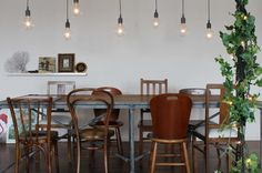 mismatched chairs & large bulbs