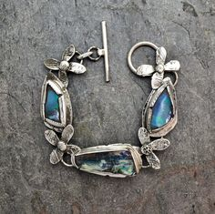 Three Blue Opals with Posies Metal Jewelry, Jewelry Shop, Jewelry Making, Broken China Jewelry, My Birthstone, Silver Work, Style Couture, Sterling Silver Cuff, Blue Opal
