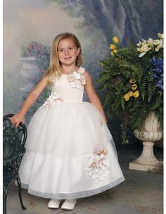 Joan Calabrese for Mon Cheri 112301 Sleeveless satin and tulle tea-length dress with jewel neckline, satin bodice accented with clusters of flowers, full dirndl double tiered tulle skirt features a matching cluster of flowers