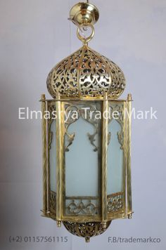 Moroccan Style Brass Lantern with White Colored Glass - Chandelier Lighting - CH 101  The weight is 10.65 KG approximately. The overall height is 80cm and 35cm width . Hand made in Egypt, the lamp body is 100% made of brass With white colored glass. It adds a uniquely foreign touch to your home! . Many hours of work through different stages were dedicated to handicraft this piece of art, it will add a great value to your place.