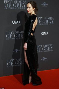 Heating things up! America actress Dakota, 27, stunned in a black backless gown asshe posed seductively