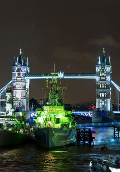 Curiously, HMS Belfast is lit green on the River Thames. Photograph: Matt Crossick/PA