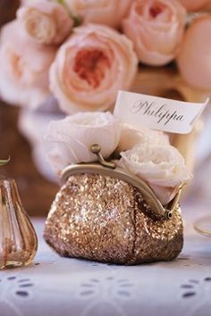 A sparkly coin purse filled with blooms is a fun idea for a place setting — and a great take away favor too!