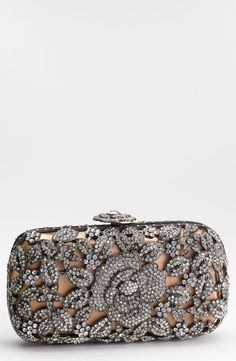Crystal caged floral clutch by Natasha Couture