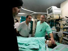Dr Lior Sasson and his fellow physicians have performed surgery on nearly children since Save a Child's Heart was founded over 20 years ago Ireland Rugby, Ap 24, Gymnastics World, World Cup Match, Riot Police, People Running, Baghdad, Doctor Who, 20 Years