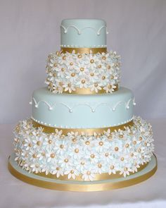 Daisy cake with light blue and gold | Hall of Cakes