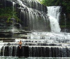 About halfway between Nashville and Knoxville, Cummins Falls cascades 50 feet over wide stair-stepped rocks into a deep cold-water pool. It's a hard-earned scramble to the bottom that involves hiking to the overlook, wading across the ankle-deep stream, climbing up to the ridge, and using a rope guide to walk yourself down to the water.
