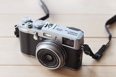 Fuji X100 .. The camera I've been using now for a year... Love the retro look of it.