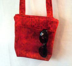 Hey, I found this really awesome Etsy listing at https://www.etsy.com/listing/107987870/red-batik-hipster-bag