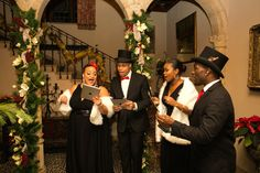 Elegant Carolers at Reception Entry   Photography: Milton Gil Photographers. Read More: http://www.insideweddings.com/weddings/catholic-ceremony-chateau-ballroom-reception-with-christmas-theme/725/