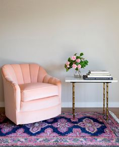 kismet rug in navy + chair + side table with books and flowers