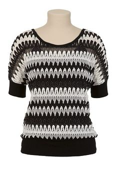 Chunky knits are in and this dressy style has a fun, nighttime vibe. The thick black and white stitching is neutral, so pop color in your bottoms or accessories. Silvery lurex thread sparkles throughout. Product of the USA. Tank top sold separately. See through; needs layering. In store style #: 88991. 95% polyester, 5% metallic. Hand wash.