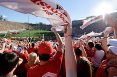 Badger fans cheer and wave rally towels during the 2012 Rose Bowl football game University Of Wisconsin Football, Never Grow Up, Rose Bowl, School Spirit, Badger, Rally, Waves, Photo And Video, Towels