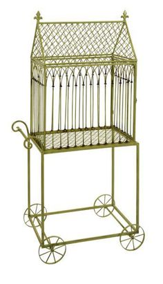 """The Varena Birdcage, with its quaint wheeled cart design, makes a beautiful display of potted plants with cascading foliage. Material: 100% Wrought Iron. 57""""h x 28.25""""w x 16.25""""."""