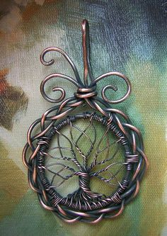 I like the braided wire circle surrounding the tree - unique touch. Celtic Tree of Life Wire Wrapped Pendant Jewelry