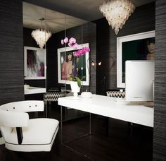 dens/libraries/offices - black grasscloth wallpaper mirrored walls glossy white lacquer desk white accent chair tear drop chandelier Stunning