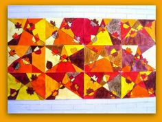 Autumn leaves in Cubist style using white paper, pencil, ruler, black permanent marker, and crayon.