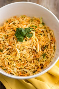 Squeaky Clean Coleslaw 1/2 medium cabbage, shredded 2 large carrots, finely grated 1 small rutabaga, finely grated 1/4 cup parsley, chopped For the Dressing 150g fresh pineapple (about 1/2 cup) 1/4 cup white wine vinegar 1/2 cup paleo mayo 1/2 tsp cayenne pepper 1/2 tsp Chinese 5 spice 1/2 tsp himalayan salt