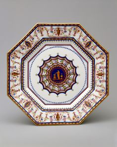 """This plate is from a remarkable service that reflected the most up-to-date Neoclassicism of the late eighteenth century. The shapes and the decoration were commissioned from the architect Louis le Masson who was instructed that the service should represent """"the most rigorous antique taste. Plate (assiette octogone or assiette platte) from the """"Service Arabesque""""  Factory:Sèvres Manufactory (French, 1740–present) Designer:Louis Le Masson (French, 1743–1829) Decorator:Jean Armand Fallot (Frenc"""