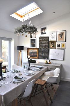 Impressive Dining Room With Skylight Gallery Wall And Touch Of Christmas Charm