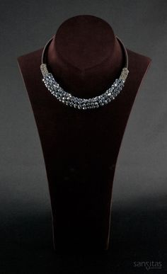 Vanity Arctic Silver - An elegant alternative to chokers and brimming with beauty. Featuring vibrant briolette crystals encased between captivating seed beads.