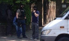 Woolwich murder: armed police arrest man in north London