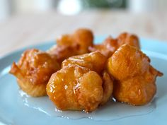 Recipe for Levivot, also known as bimuelos. Family recipe from Israel for Hanukkah. Fried batter topped with rose water sugar syrup. Dairy, Kosher, bunuelos