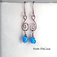 Jewelry, handmade, wire wrapped earrings-Swirled Stainless Steel Sky Blue Glass Beaded by KDTwistedElements, $22.00