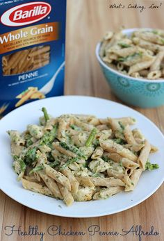 Healthy Chicken Penne Alfredo.  A delicious and healthy pasta dish made using Better for You Barilla Whole Grain Pasta, topped with chicken, asparagus, and a cauliflower alfredo sauce.